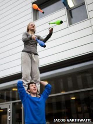 Hollie Johnson juggling on Lee Tinnion's shoulders. Photo: Jacob Garthwaite