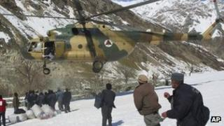 Afghan military helicopter carrying emergency supplies (file photo March 2012)