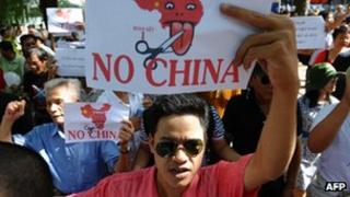 Vietnamese protesters shout anti-China slogans during a rally in the centre of Hanoi on August 14, 2011