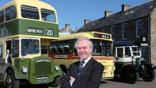 Secretary of the FirstGroup Heritage Trust, Joe Mackie, with three of the trust's vehicles
