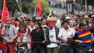 Indigenous and non-indigenous people protest the policies of President Rafael Correa as they march near the National Assembly March 22, 2012