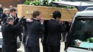 Chris McManus's coffin is carried out of the church