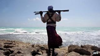 A Somali pirate gazing at the captured MV Filitsa, 7 January 2010