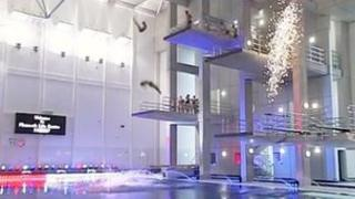 Divers perform at the opening of the Life Centre