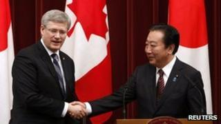 Canadian Prime Minister Stephen Harper shakes hands with his Japanese opposite number Yoshihiko Noda
