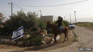 Jewish settler rides horse in Migron settlement - 8 February