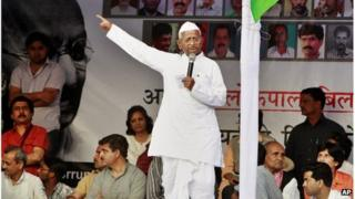 "India""s anti-corruption activist Anna Hazare gestures as he speaks during his daylong hunger strike at Jantar Mantar in New Delhi, India, Sunday, March 25, 2012"