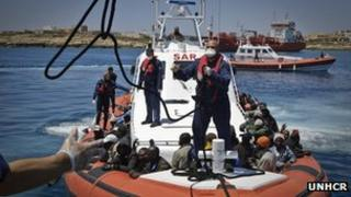 refugees on Italian coastguard boat