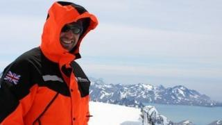 Mike Curtis stands in the Antarctic