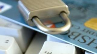 Padlock on top of credit card and keyboard