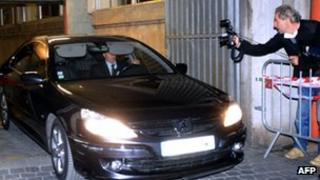 Dominique Strauss-Kahn leaves in the back of a car after being heard by judges on 26 March, 2012 Lille