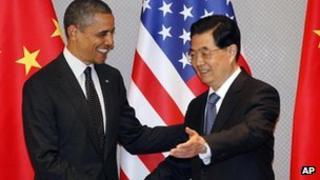 Barack Obama (left) and Hu Jintao shake hands to start their bilateral meeting in Seoul, 26 March 2012