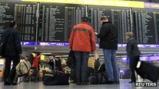 Passenger look at departures board at strike-hit Frankfurt airport on 27 March 2012