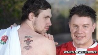 John Adam shows his Wales tattoo with friend James Griffiths