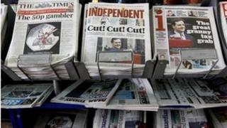 Budget headlines on newsstand