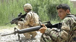 An archive image of a soldier from the First Battalion the Royal Regiment of Scotland on a training exercise with an Afghan National Army soldier