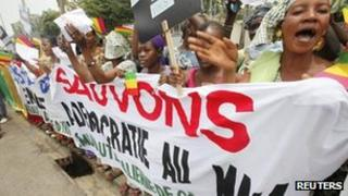 Malians living in Ivory Coast protest against a coup in their country during the Extraordinary Meeting of ECOWAS in Abidjan