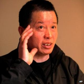 Gao Zhisheng gestures during a media interview before he went missing at a tea house in Beijing, 7 April 2010