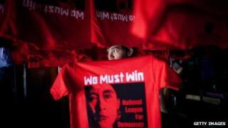 A Burmese worker hangs up freshly silkscreened National League for Democracy party (NLD) tshirt ahead of the parliamentary elections March 26, 2012