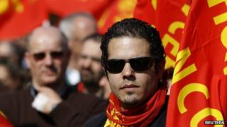 Workers from Italy's radical metal-workers union Fiom hold an eight-hour strike in Rome, 9 March