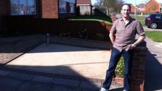 Steve Woolnough in his garden in Ipswich