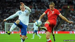 England's Wayne Rooney and Wales's Craig Bellamy in Euro 2012 qualification action