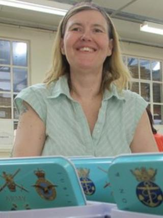 Sue Carrington with the commemorative biscuit tins