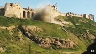 Still from activists' video purporting to show castle at Qalaat al-Mandiq being shelled (21 March)
