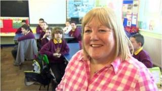 Audrey McKee and the children from Milburn Primary School, Coleraine