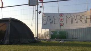 A tent and campaign poster