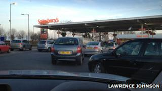 A queue of vehicles waiting to buy fuel at a petrol station in Monks Cross, York.
