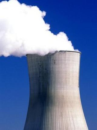 Steam billowing from nuclear power plant reactor
