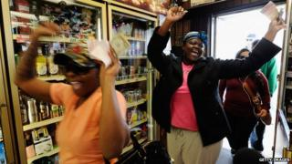 Women celebrate after purchasing lottery tickets
