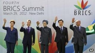 Brics leaders wave together during the group picture for the fourth Brics Summit in New Delhi, 29 March 2012