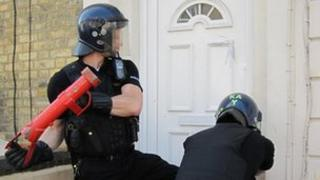 Kent Police officers raid a property in Maidstone