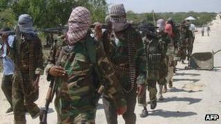 Al-Shabab recruits walk down a street on 5 March 2012 in Deynile to the west of Mogadishu