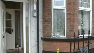 The pipe bomb caused damage to the front of the house