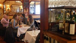 Diners at a bistro table