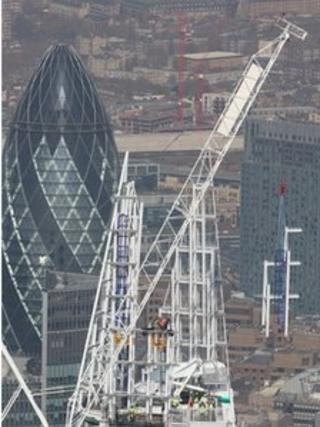 The highest part of the Shard is craned into place