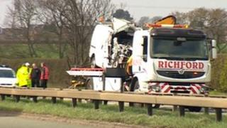 Damaged van on a recovery vehicle on the A52