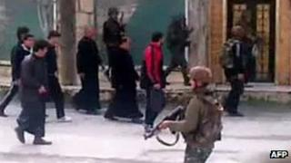 Syrian troops round up civilians in the village of Kafr Nabl in Idlib province (grab from video uploaded by activists on 30 March)