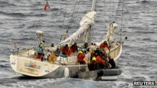 US Coast Guard crew work to transfer the two injured crew