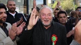 George Galloway waves to supporters before an open top bus tour in Bradford