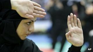 Member of a group of female Iranian ninjutsu athletes trains in Karaj, west of the capital Tehran, on 15 March 2012