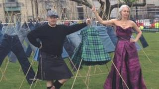 Professor Helen Storey and Professor Tony Ryan in their field of kilts and jeans in St Andrew Square