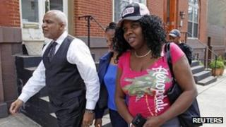 Mirlande Wilson arrives with her lawyer Edward Smith Jr at a news conference in Baltimore, Maryland 4 April 2012