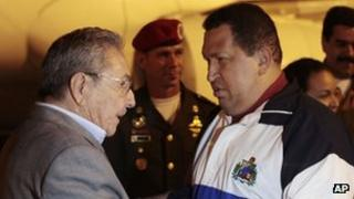 Cuban President Raul Castro (left) greets Hugo Chavez on his arrival in Havana on 31 March 2012