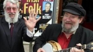 Barney McKenna, right, serenades fellow Dubliner Ronnie Drew, also deceased