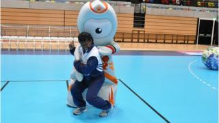 Sisilia Naisiga Rasokisoki taking on Olympic mascot Wenlock in the London 2012 Copper Box