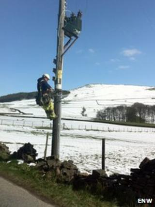 An engineer working on a telegraph pole in Glossop